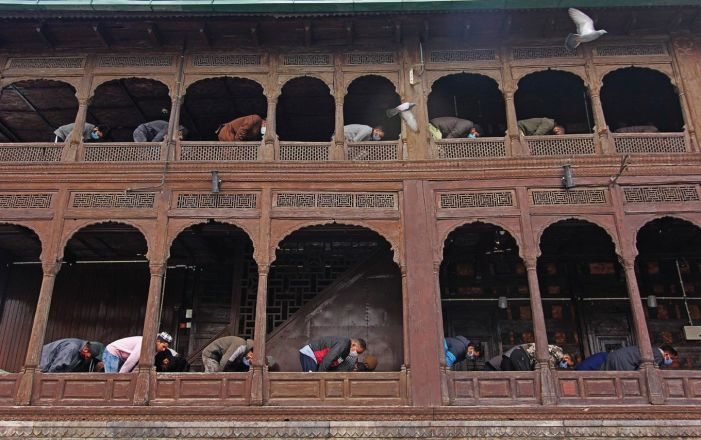 People offer prayers at Khanqah-e-Moula in Srinagar on Friday