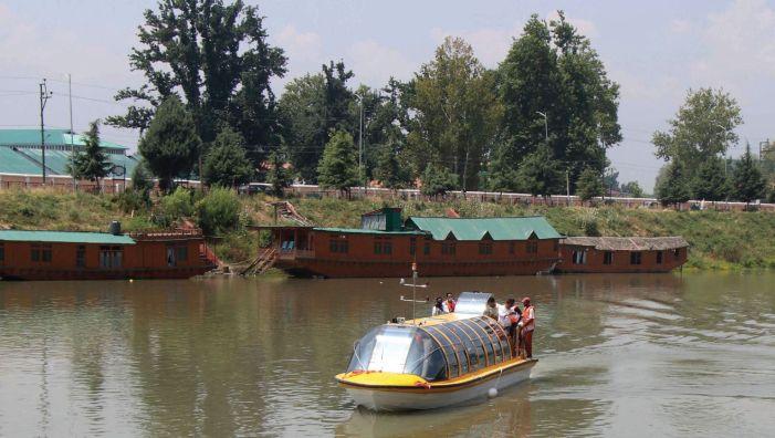 A boat through Srinagar being readied on the Jhelum