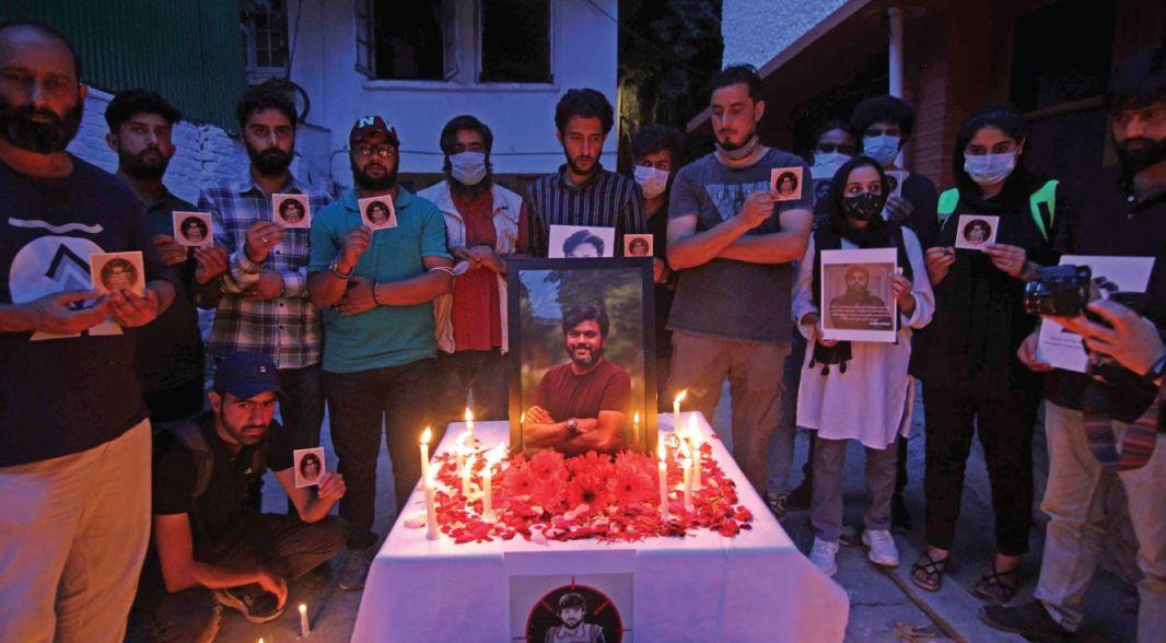 Journalists hold candlelight vigil in Srinagar in memory of slain Reuters photojournalist Danish Siddiqui.