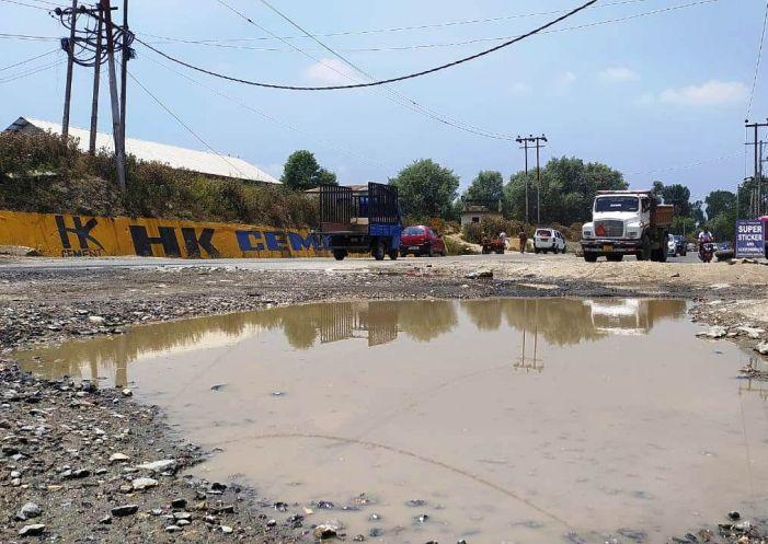 Potholes on NH near Sempora irks commuters