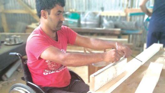 Setting standards: 'Lifeless' below waist, wheelchair bound Pulwama man runs his joinery unit