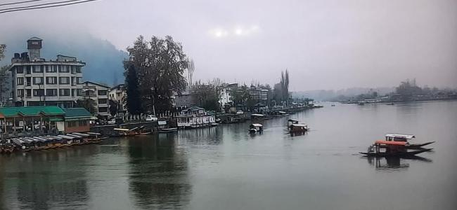 The serenity and the calm witnessed at the world famous Dal Lake on Monday as rains lashed most parts of Jammu and Kashmir bringing down the temperatures as well. (Pic captured by Er. Aamir Ali)