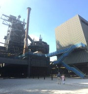 Visitors take in the blast furnace from below.