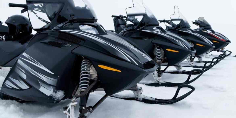 line of black snowmobiles