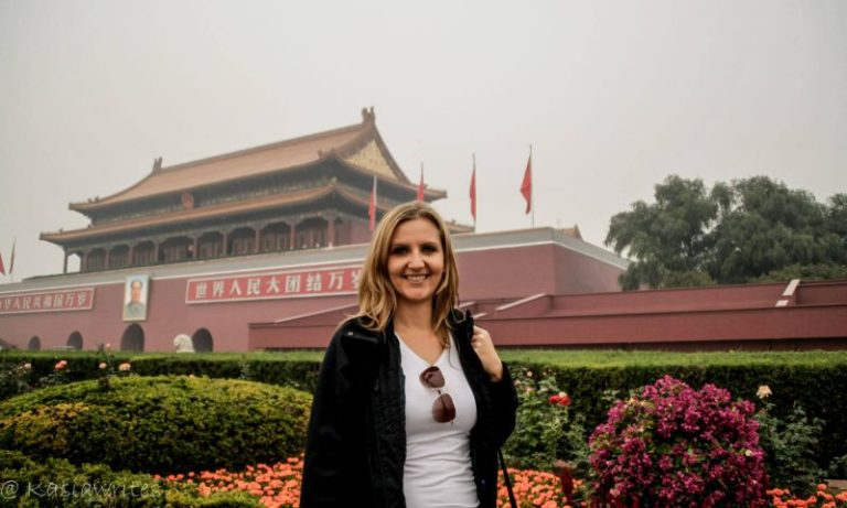 woman in front of the gate to the forbidden city