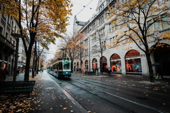 tram on a street with leaves falling