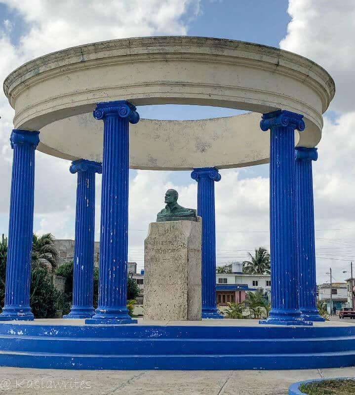 blue columns surrounding a bust