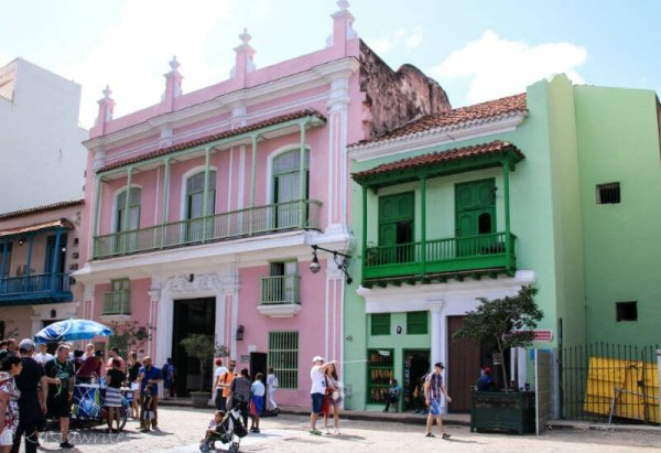pink and green buildings in Havana