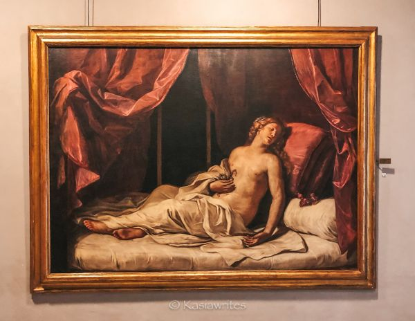 painting of a woman lounging