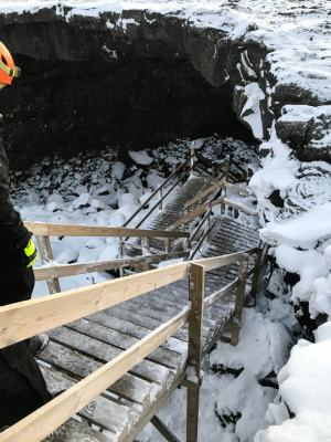 entrance to lava cave down wooden steps