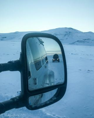 truck seen in a side view mirror of a car