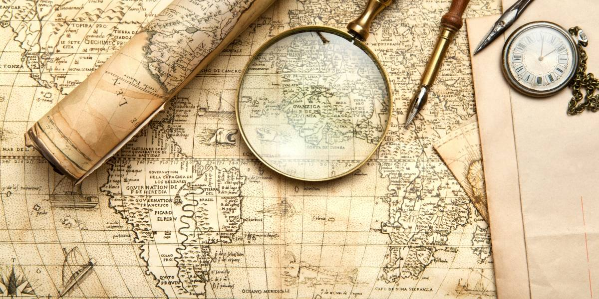 the world of travel with old map and magnifying glass