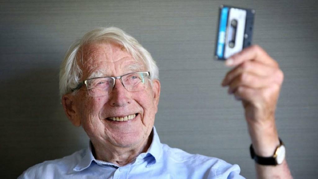 cassette tape inventor lou ottens holding a cassete