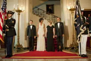Angela Merkel, her husband Joachim Sauer and Michelle and Barrack Obama on their way to dinner in White House's Rose garden