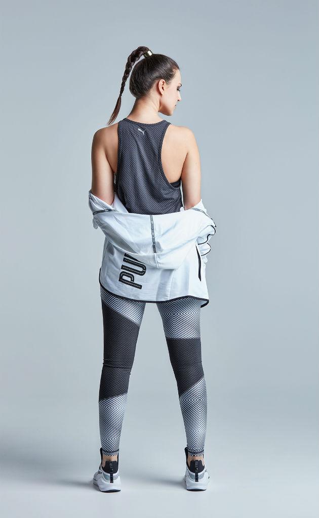 Katharina im Sportoutfit von Puma mit dem Rücken stehend