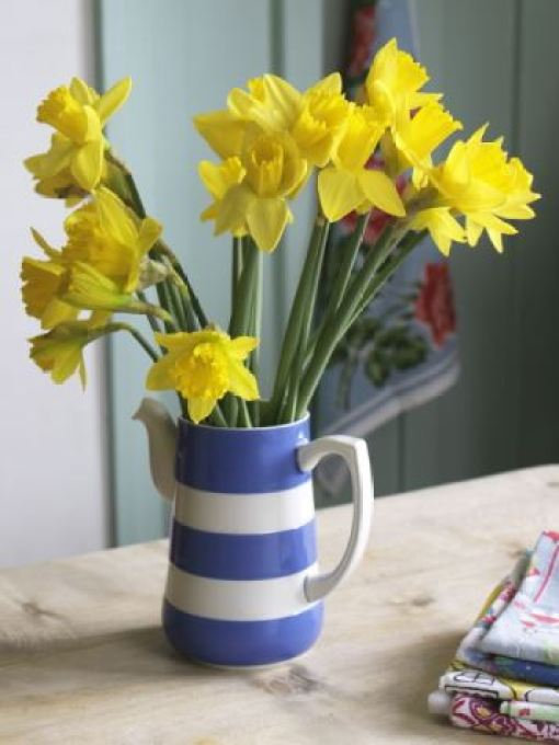 spring flowers in  vintage cornish ware from Style YTour Modern Vintage Home photo by Simon Whitmore written by Kate Beavis