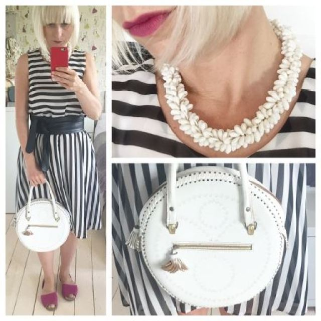 Black and White geometic dress and vintage accessories worn by Kate Beavis