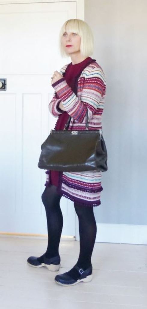 1960s vintage style Primark mini dress with long pom pom Monsoon cardigan worn with Lotta from Stockholm clogs, vintage handbag and pink trilby - Vintage Fashion worn by Kate Beavis