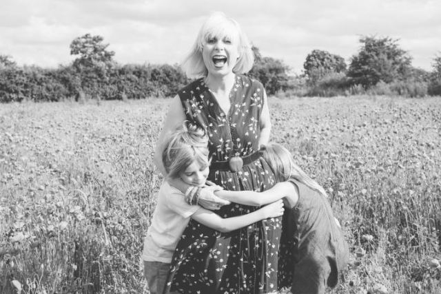 Kate Beavis in the poppy field photographed by Sharon Cooper