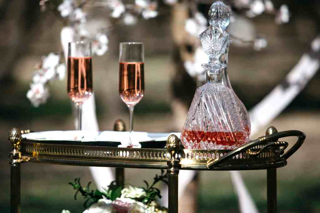 detail of champagne glasses in an almond orchard