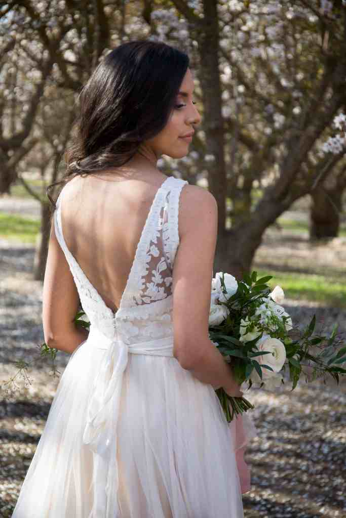 bride showing the back of her BHLDN dress