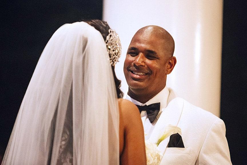 groom smiling at his bride
