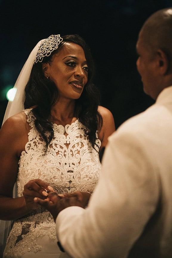 bride exchanging wedding ring