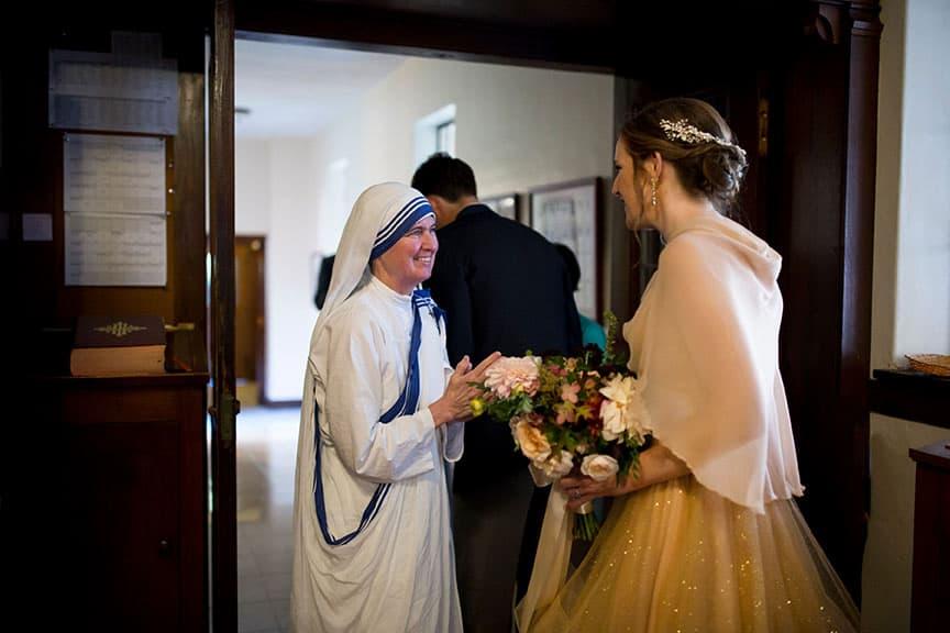 Bride talking to a nun