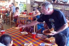 Michael serves hot dogs