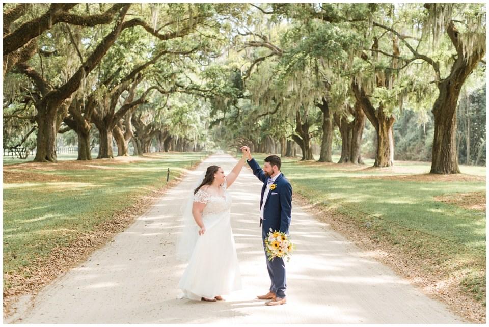 groom twirls bride in Charleston SC