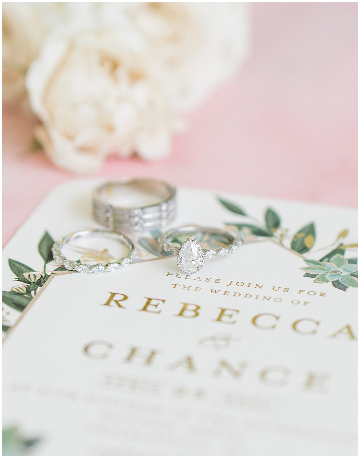 wedding rings rest on wedding invitation for Cannon Green wedding