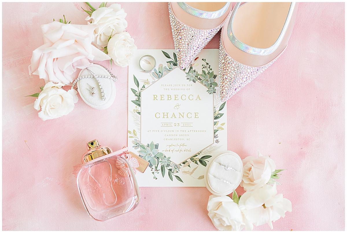 spring wedding details with floral invitation suite