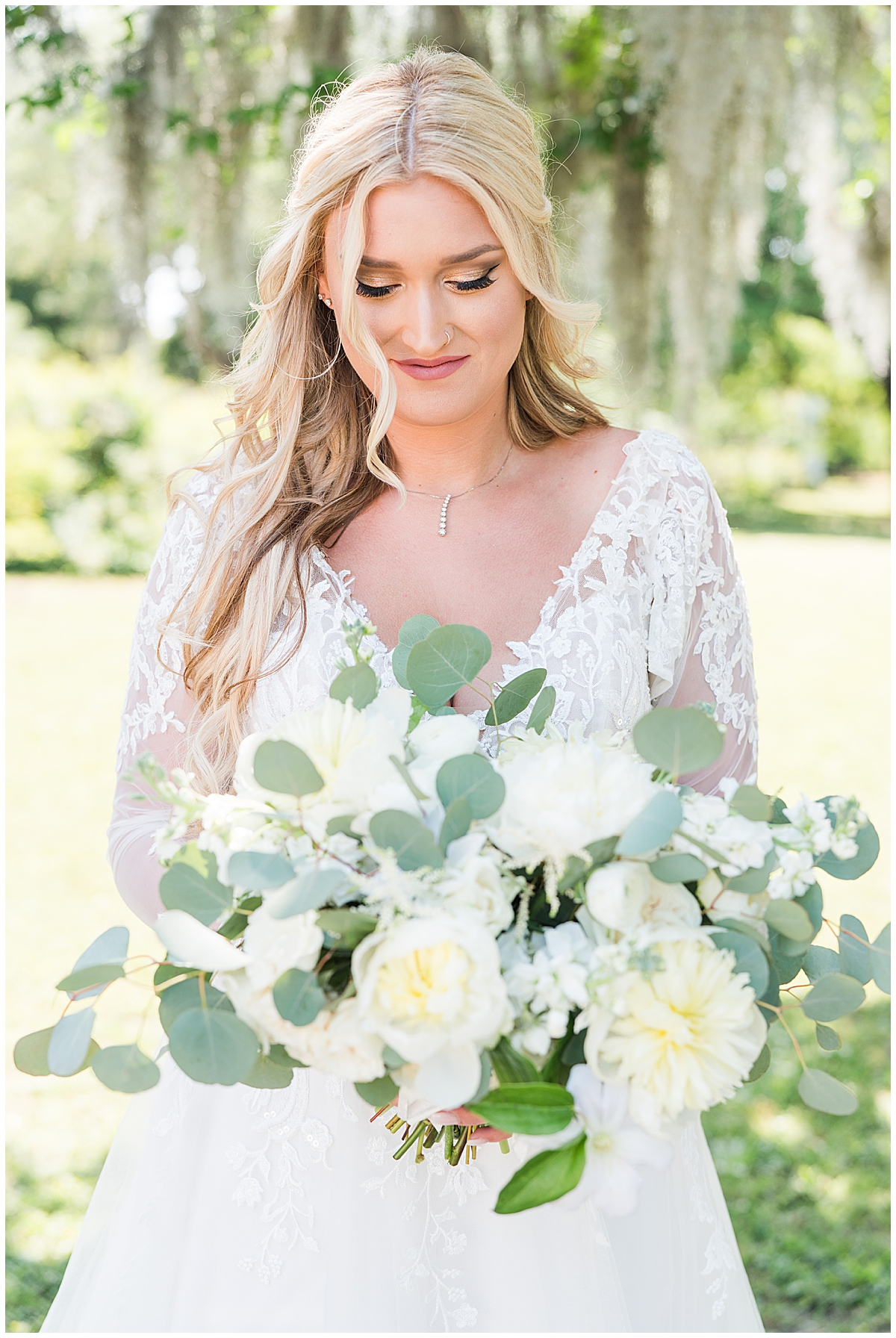 Charleston bride holds bouquet and looks down at flowers