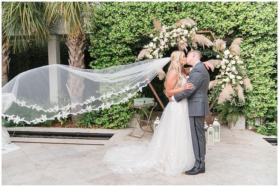 Cannon Green wedding portraits with bride's veil floating