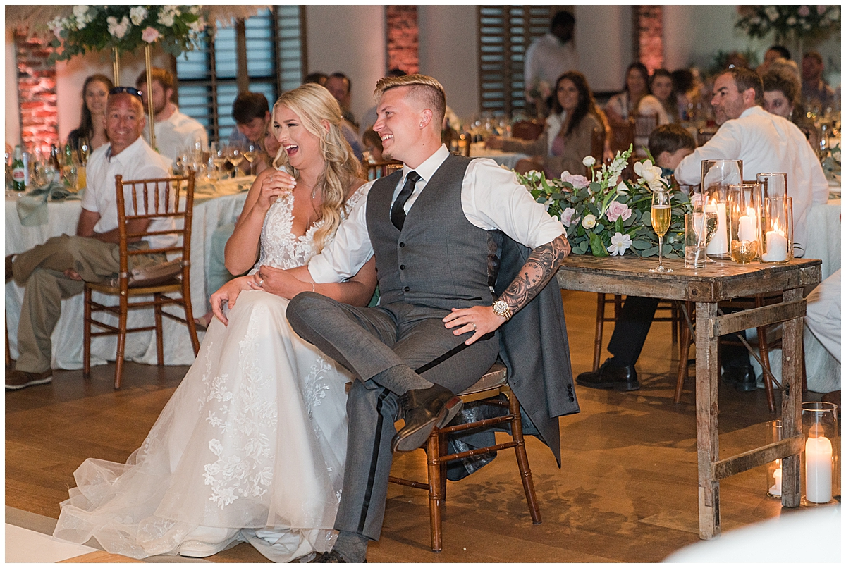 bride and groom sit during toasts at Cannon Green