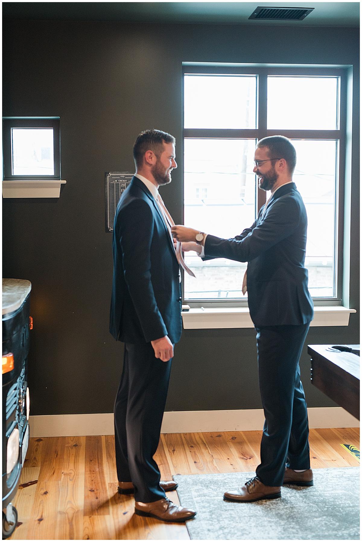 groom and groomsmen prepare for Charleston wedding