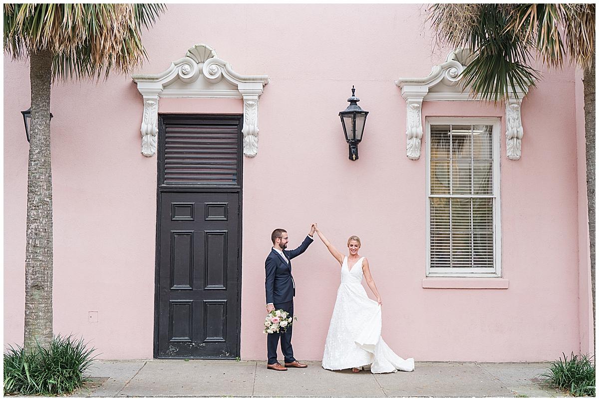 groom twirls bride during SC wedding photos