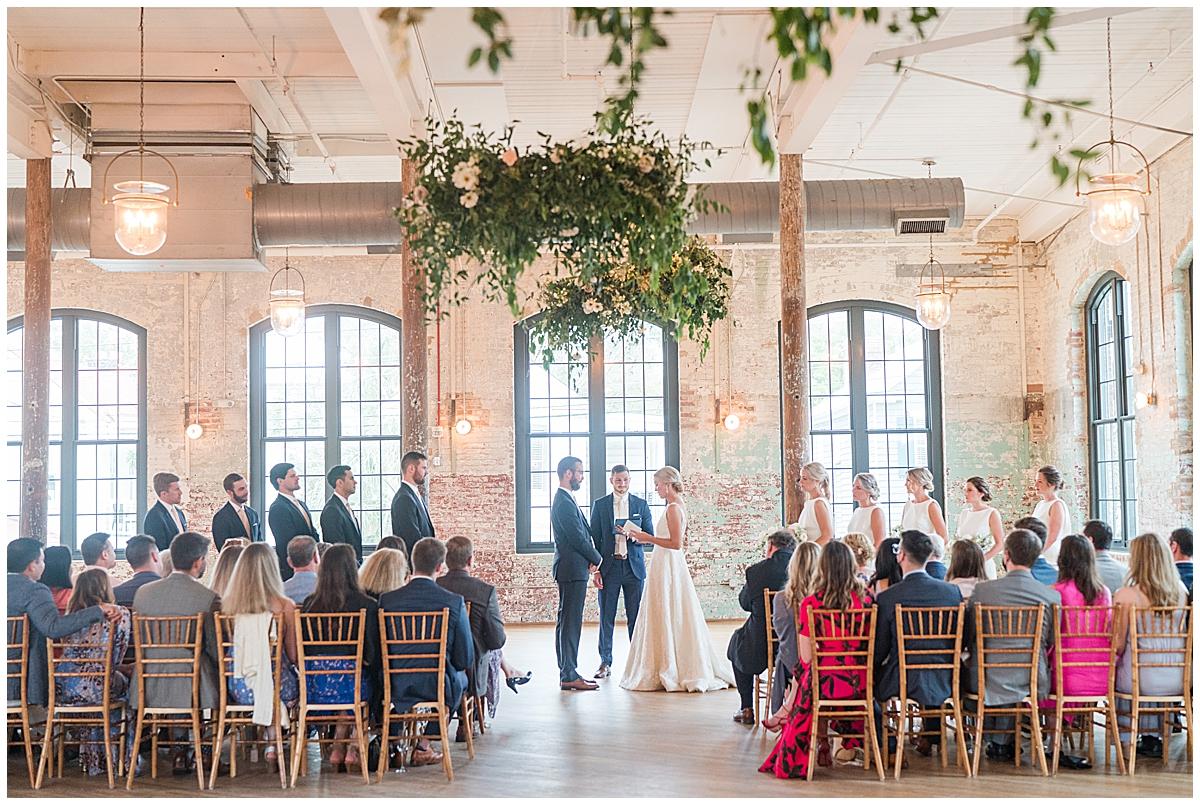 bride and groom exchange vows in Cedar Room Charleston
