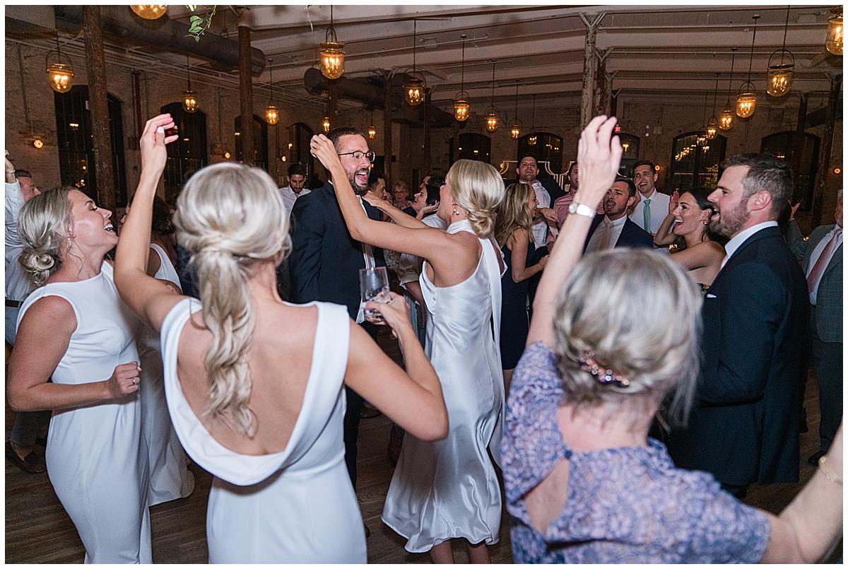 bride dances with groom during wedding reception in Charleston