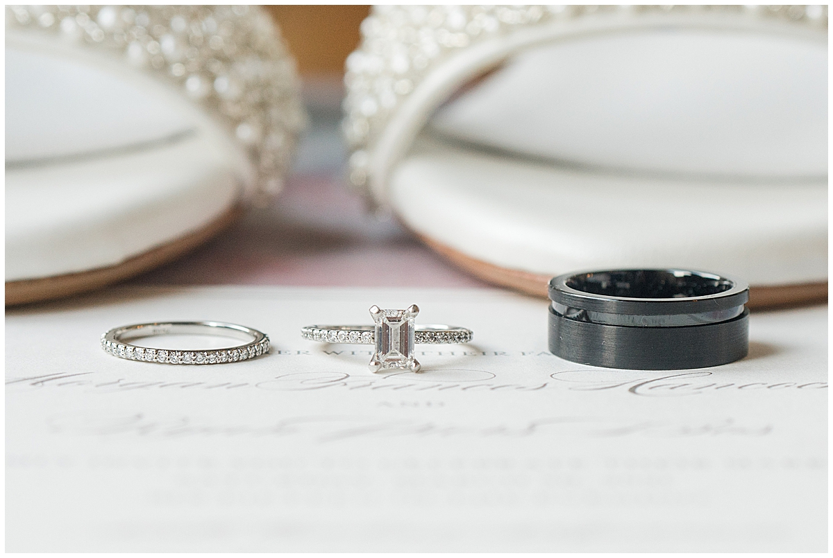 wedding rings rest on invitation suite in Charleston