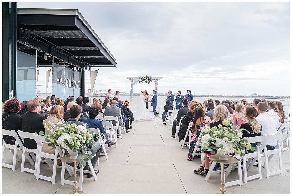 bride and groom kiss during Charleston Aquarium Wedding ceremony