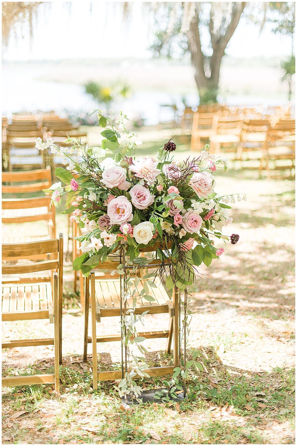 floral display outside ceremony at Runnymeade Plantation Charleston wedding