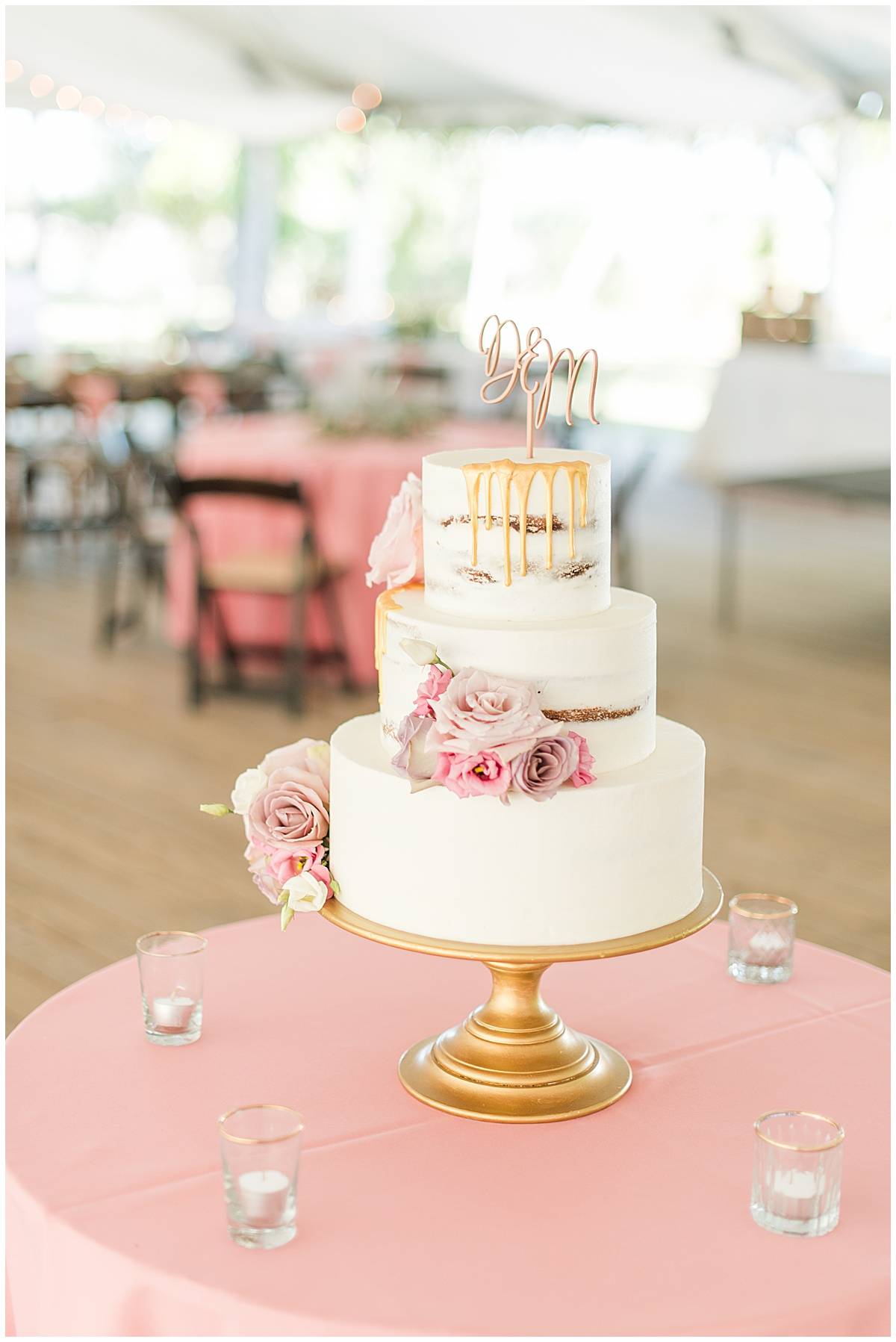 tiered wedding cake with gold drip icing