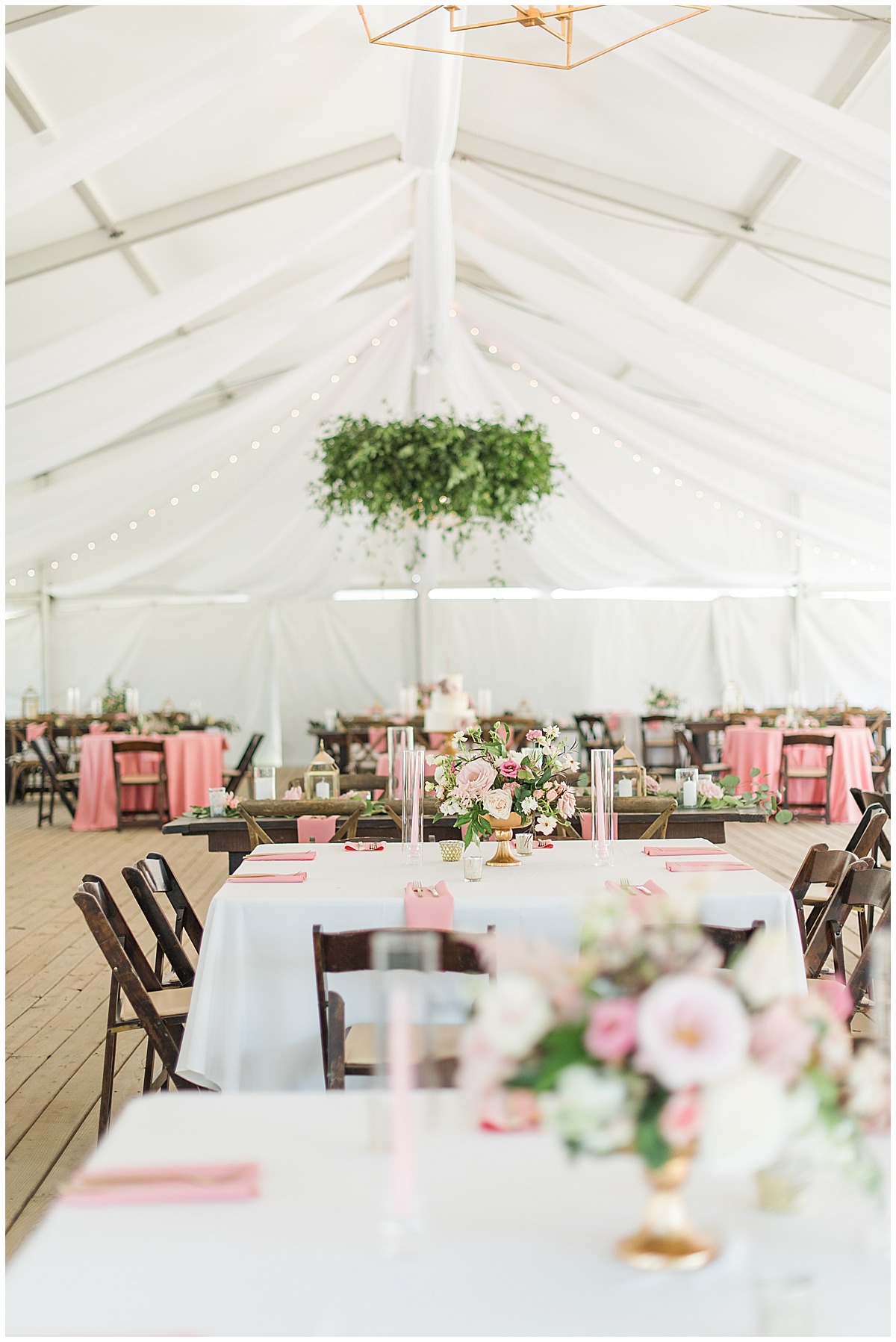 Runnymeade Plantation Charleston wedding reception under tent with hanging green floral display