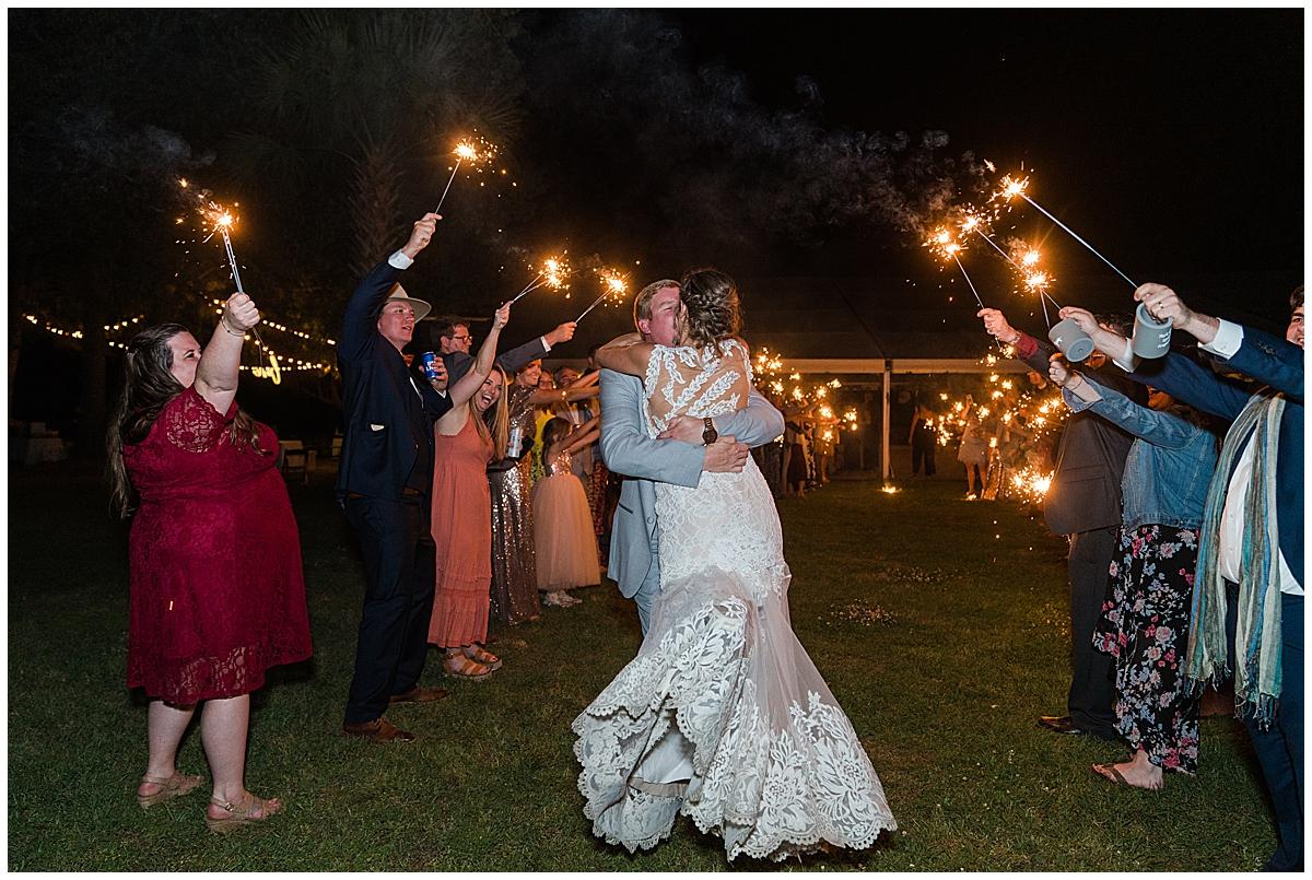 bride and groom hug during sparkler exit at Runnymeade Plantation