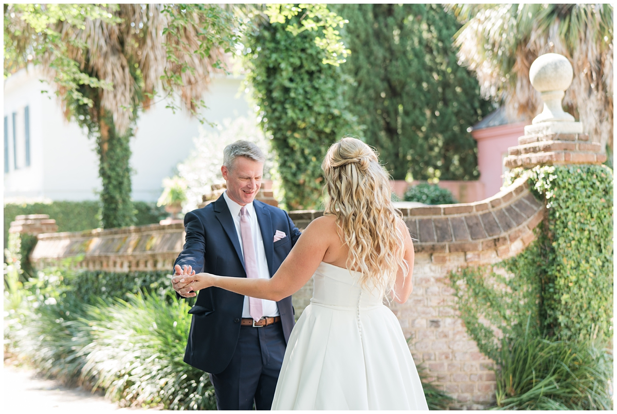 groom sees bride for the first time during first look