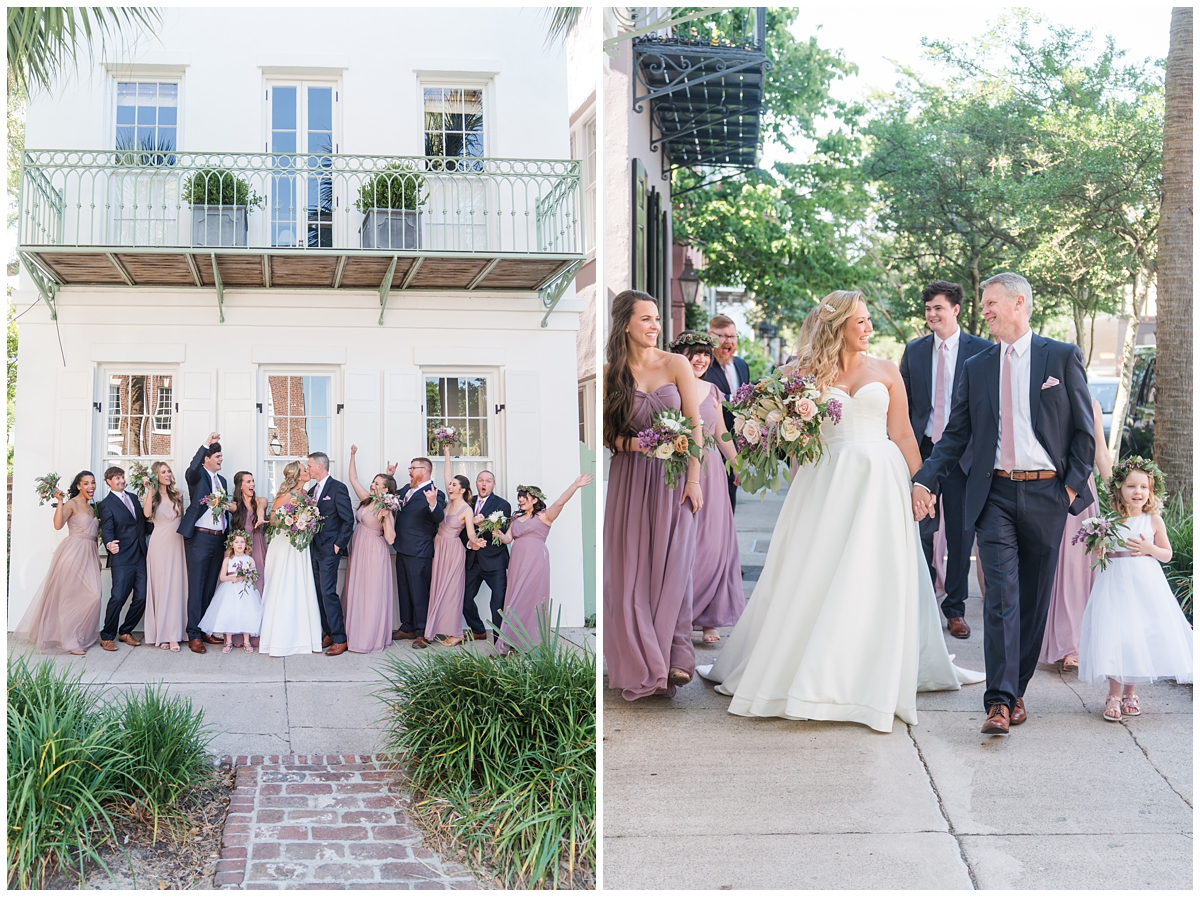 bride and groom walk with bridal party in pink gowns and blue suits