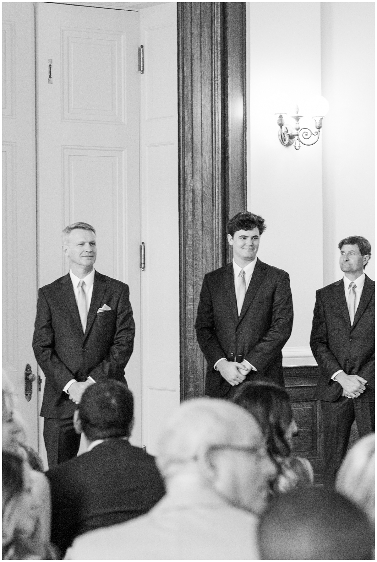 groom watches bride walk down aisle at Gibbes Museum wedding ceremony