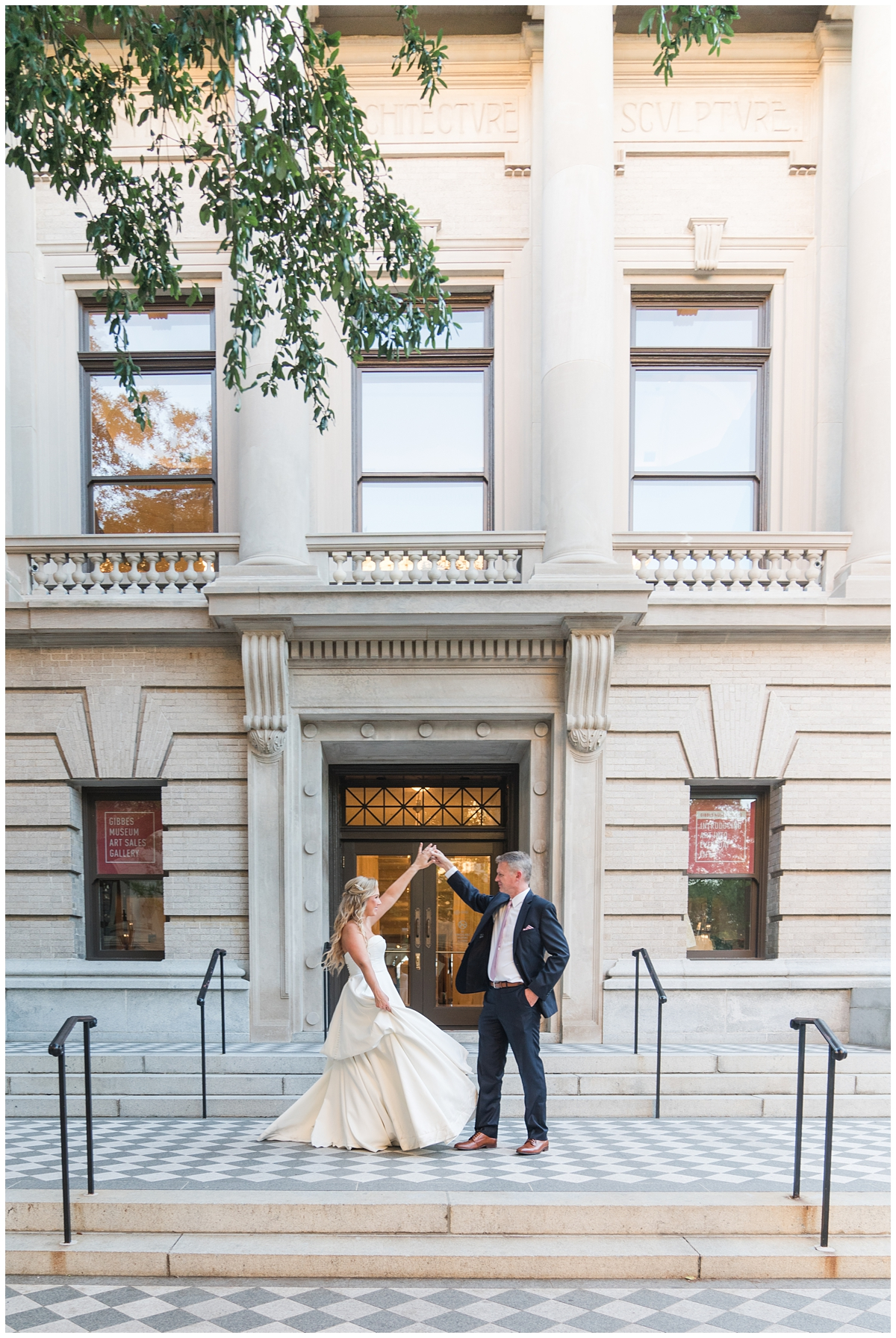 Gibbes Museum wedding portraits of bride twirling with groom