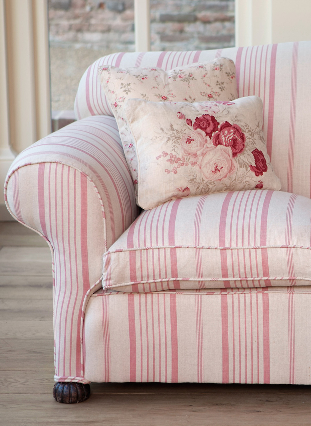 Pink Ticking Sofa with roses and sprig cushions  Kate Forman